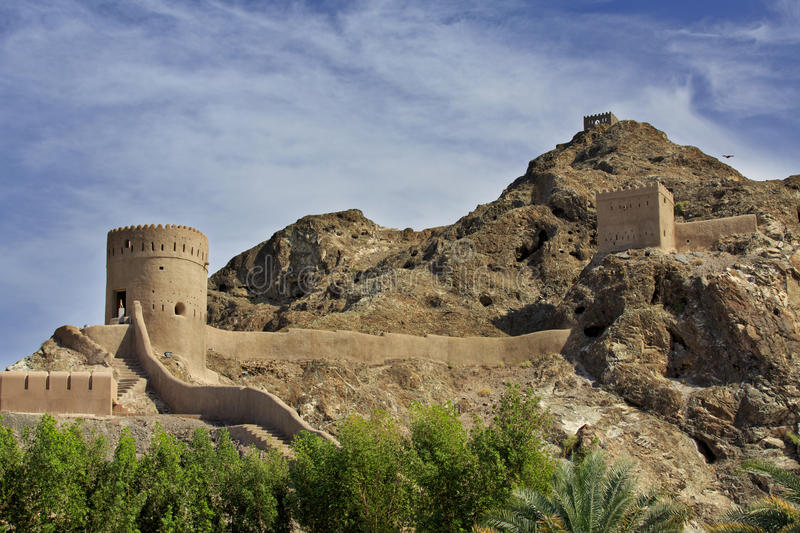Watchtowers and defending walls and mountains in Old Muscat stock photography