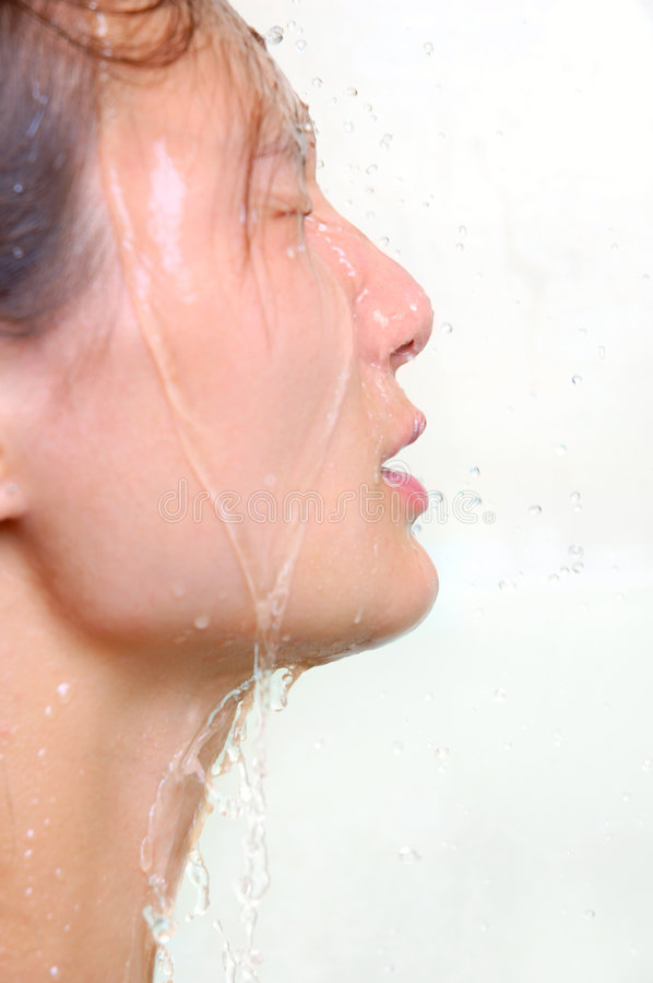 Water. Young woman face under shower feminine hygiene and beauty concept royalty free stock image