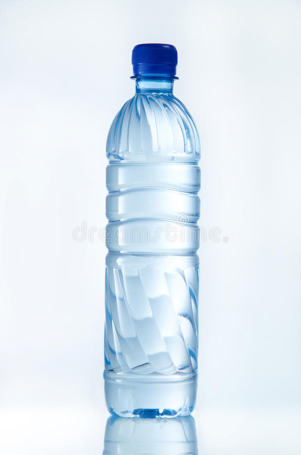 Water. Bottle of mineral water with reflection on clean background stock images