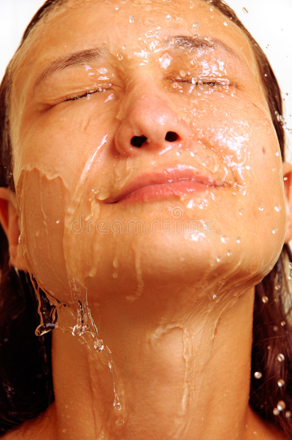 Water. Young woman face under shower feminine hygiene concept royalty free stock images