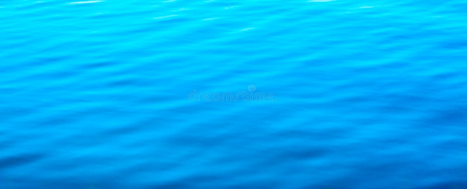 Water abstract background. Blue water ripples texture pattern royalty free stock photos