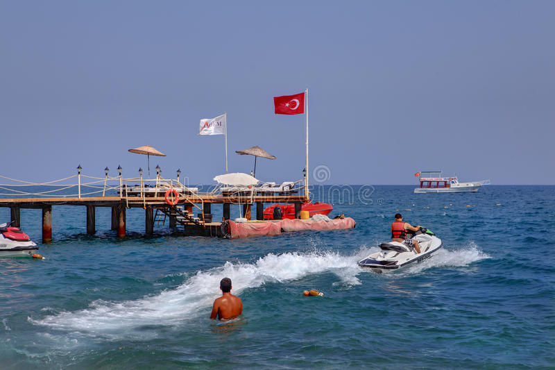 Water Activities on holiday in resort of Kemer, jet skiing. Kemer, Turkey - August 29, 2014: Water sports on vacation in Antalya resort, jet skiing, private stock photography