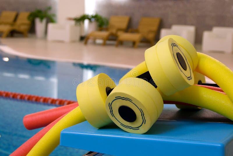 Water aerobics equipment. Aqua noodles dumbbells for aqua aerobics on the coast in pool stock photo