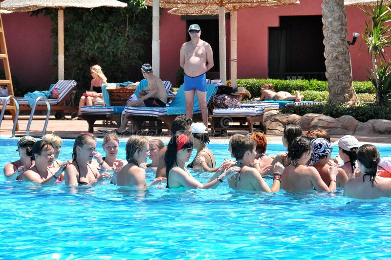 Water aerobics in the pool Egyptian hotel. Water aerobics in swimming pool in Hotel Sea Group of Egypt, rest in the resort of the Red Sea in Sharm el-Sheikh royalty free stock image