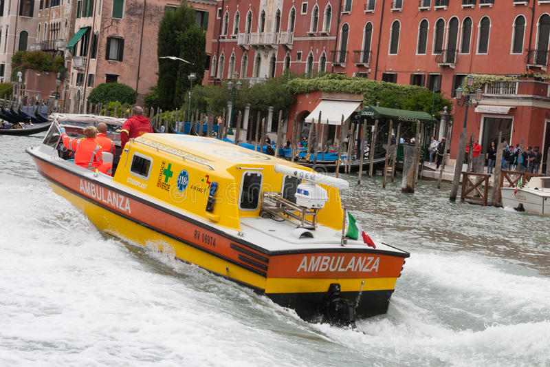 Water ambulance on the Grand Canal in Venice, Italy. A water ambulance making its way on the Grand Canal in Venice, Italy stock photo