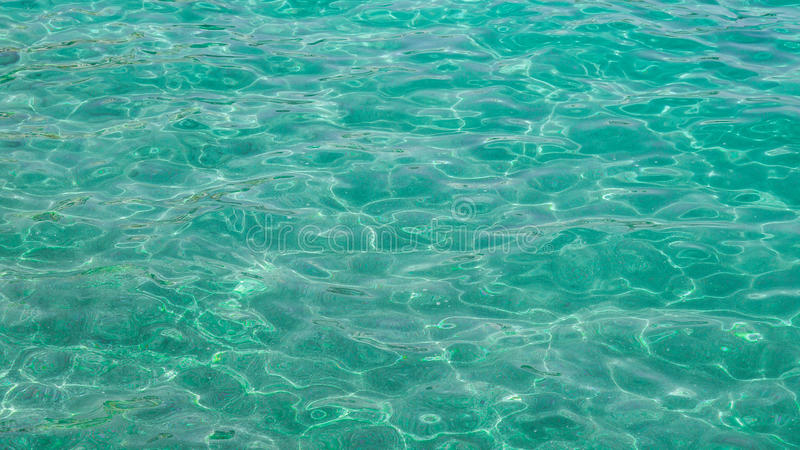 Water background blue-green. Blue-green transparent and clean sea water background stock photo
