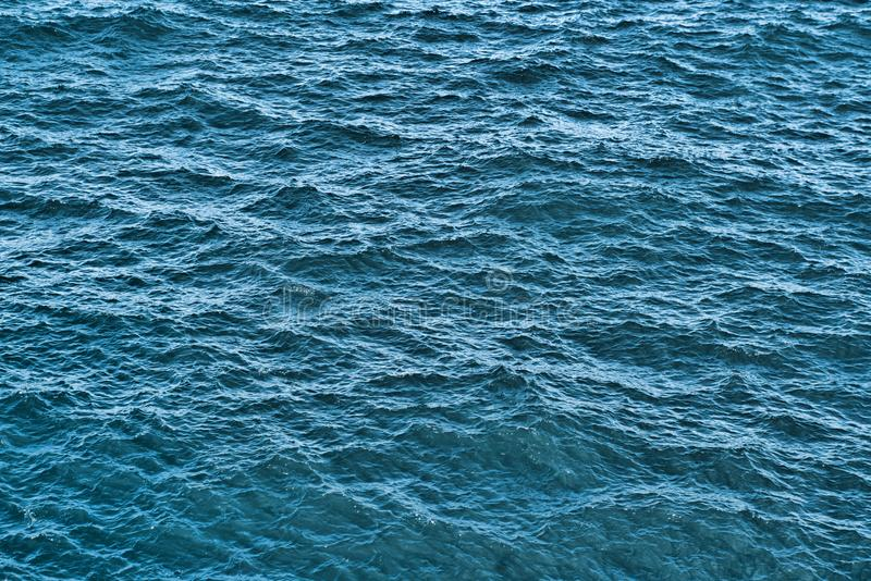 Water background texture. Sea surface in sunset light royalty free stock photos