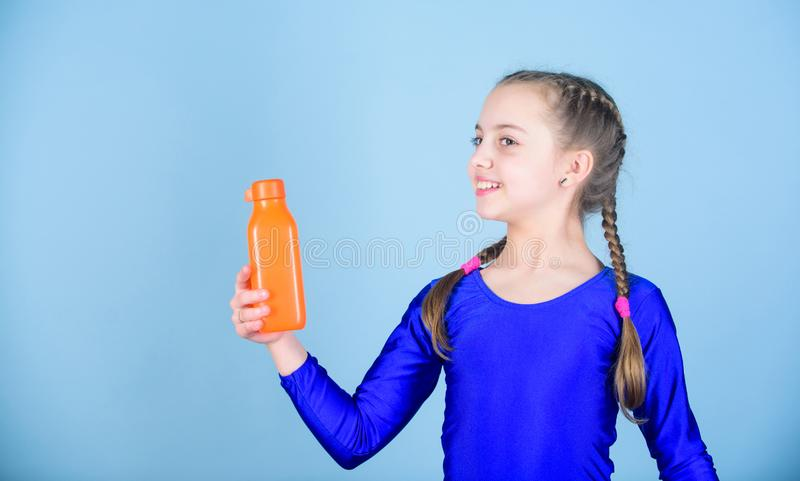 Water balance and hard gym training. Drink more water. Keep water bottle with you. Quench thirst. Child feel thirst. After sport training. Kid cute girl gymnast royalty free stock image