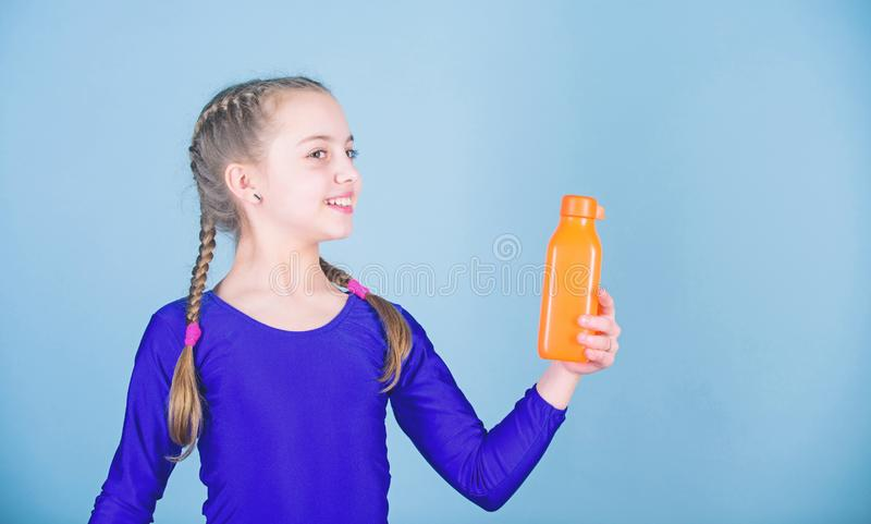 Water balance and hard gym training. Drink more water. Keep water bottle with you. Quench thirst. Child feel thirst. After sport training. Kid cute girl gymnast royalty free stock photos