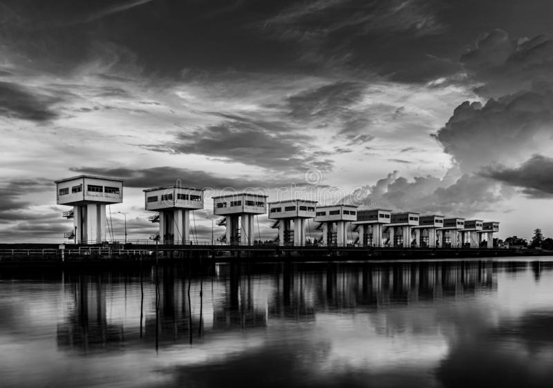 Water barrier with cloud sky and river, Black and white and monochrome style stock images