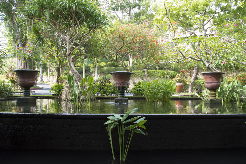 Water basin and amphoras in garden of Resort, Bali royalty free stock photo