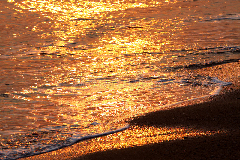 Water & Beach at Sunset royalty free stock images