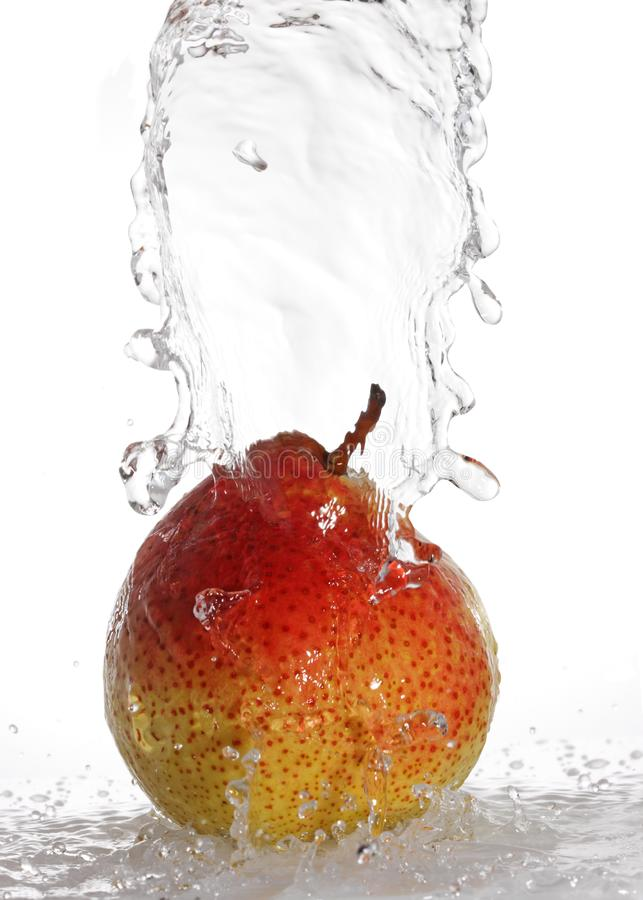 Water being poured on a pear