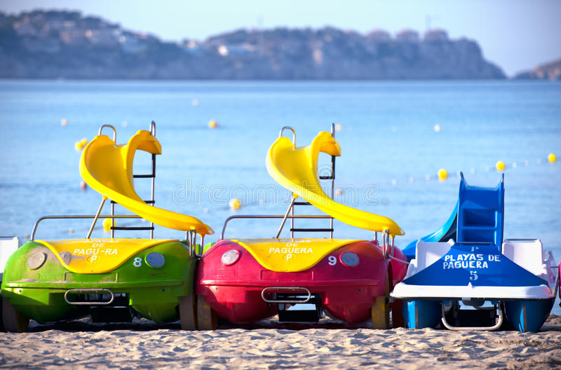 Water Bicycles on a Sandy Beach of Mallorca, Spain royalty free stock photo