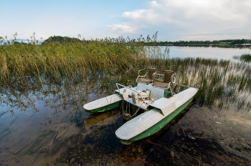 Water bike. Evening. Lake Plateliai and water bike in the lake stock photography