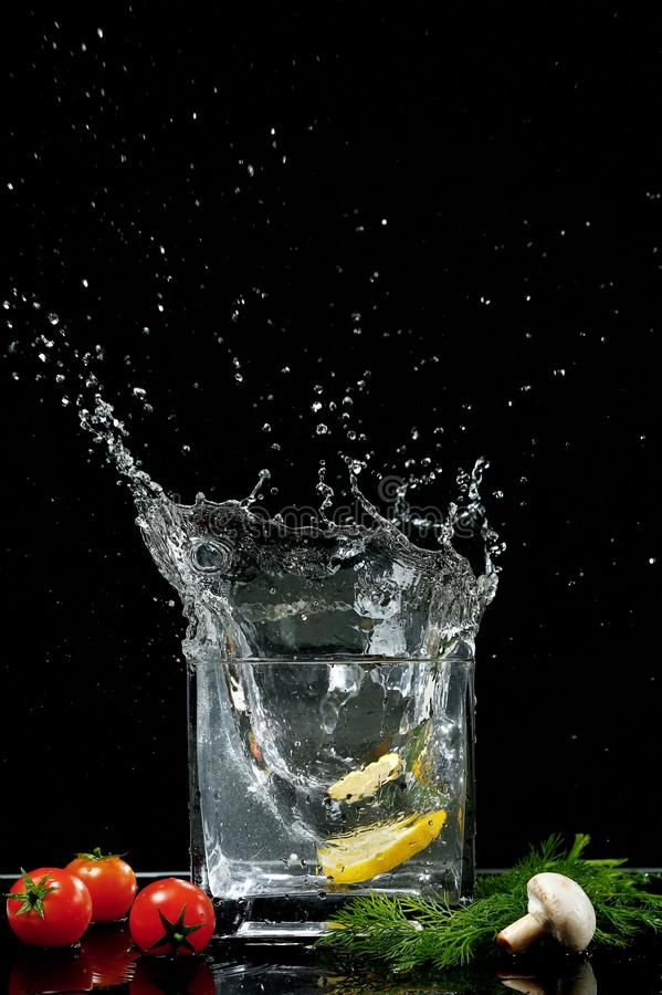 A splash of lemon and water stock photography