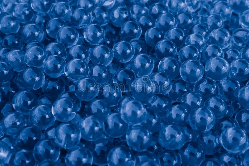 Water blue gel balls with bokeh. Polymer gel. Silica gel. Balls of blue hydrogel. Crystal liquid ball with reflection. Blue textur royalty free stock images