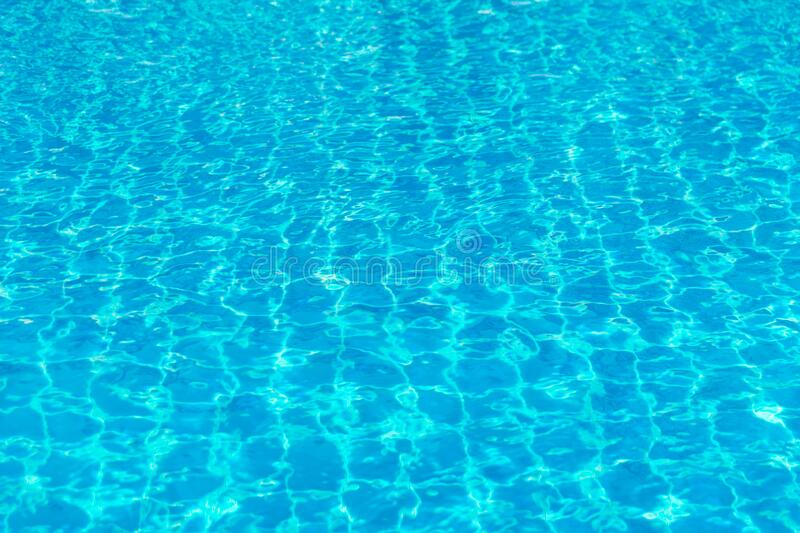 Water blue a swimming in the pool stock photos