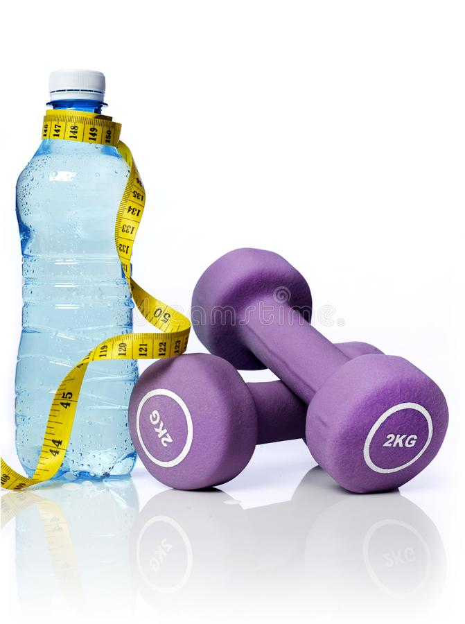 Water bottle and dumbbells royalty free stock images