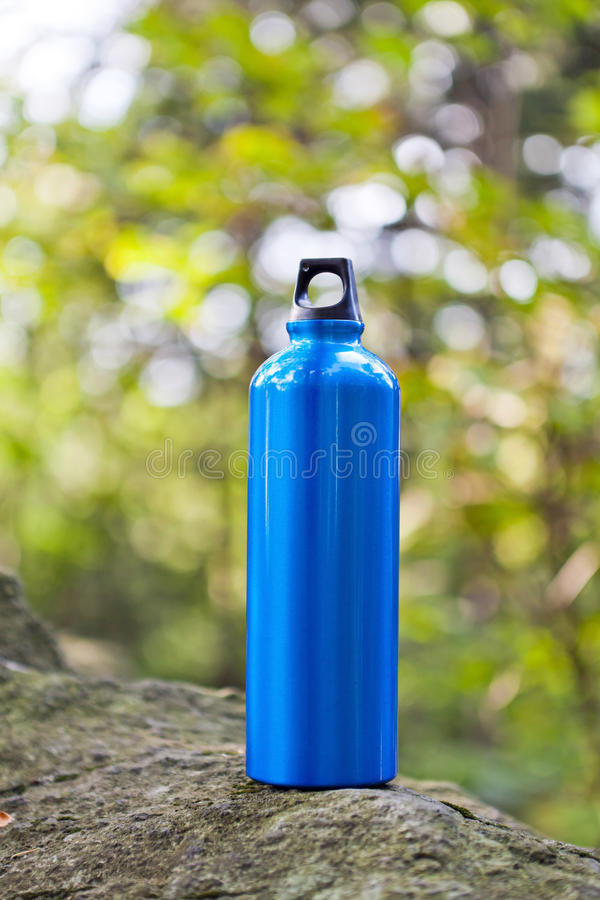 Water bottle in green forest royalty free stock photos