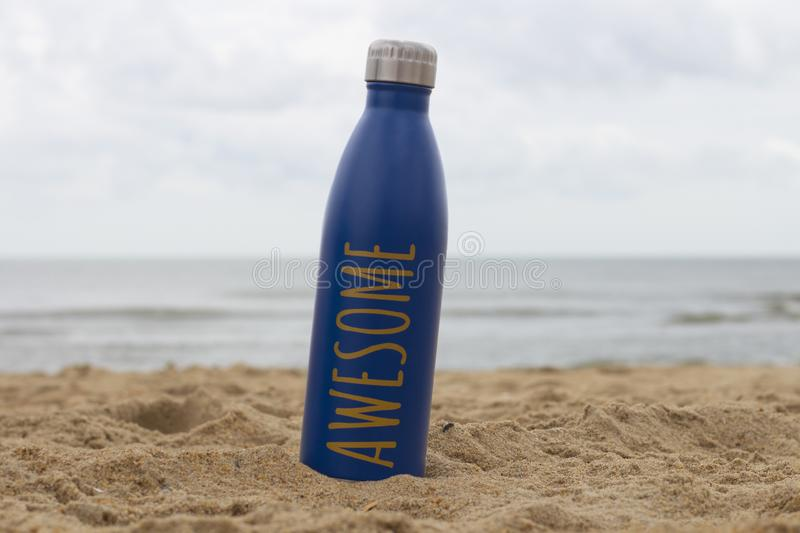Water bottle sits on the beach stock photos