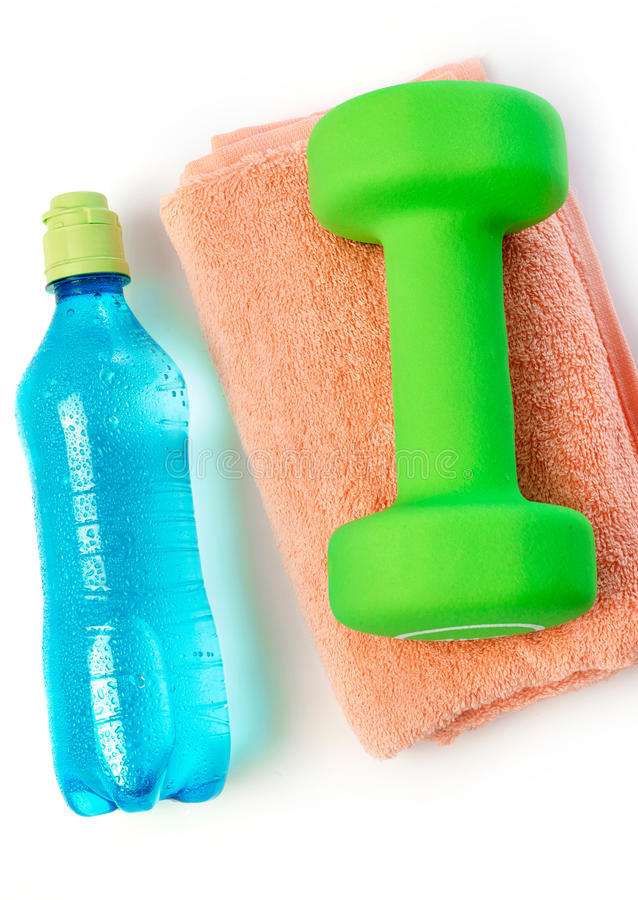Water bottle, towel and dumbbell royalty free stock photos