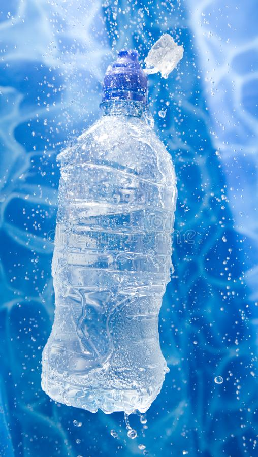Water bottle in a water splash stock photography