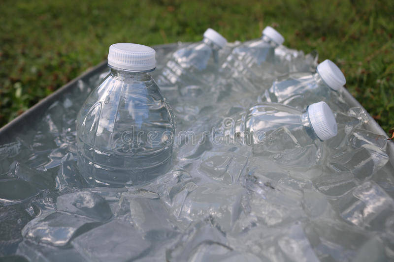Water bottles in ice stock images