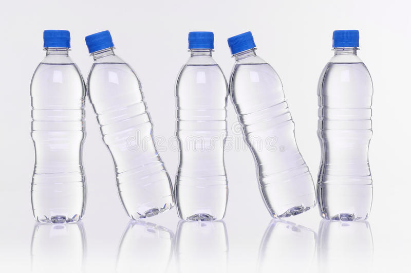 Water bottles reflection stock image