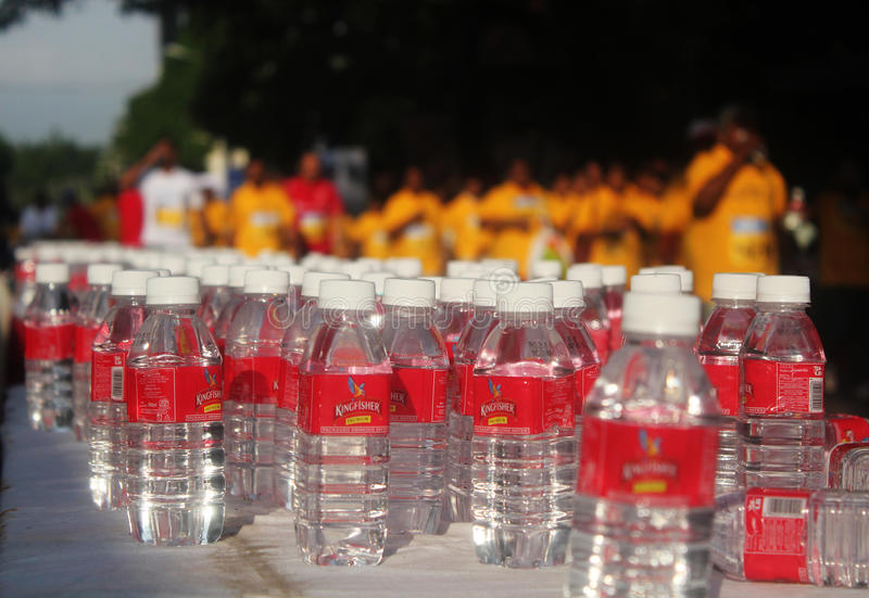 Water bottles in TCS World 10k bangalore marathon. Bangalore, India - May 27: Water bottles from kingfisher for participants during Tata Consultancy Services royalty free stock image