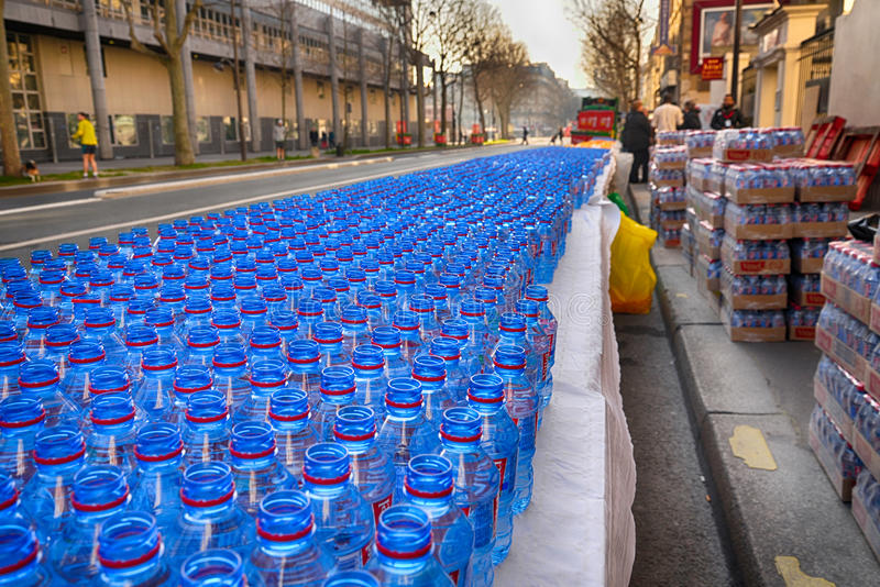Water bottles to marathon competitors stock images