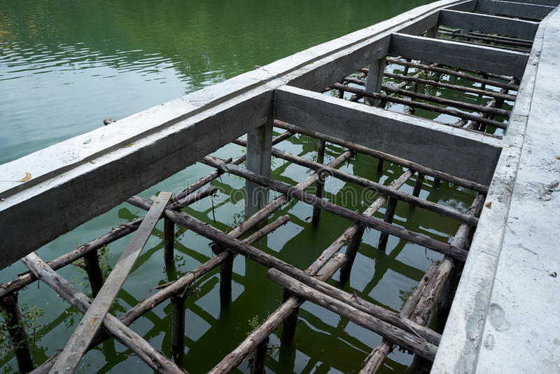 Water bridge construction beside the green lake stock photo