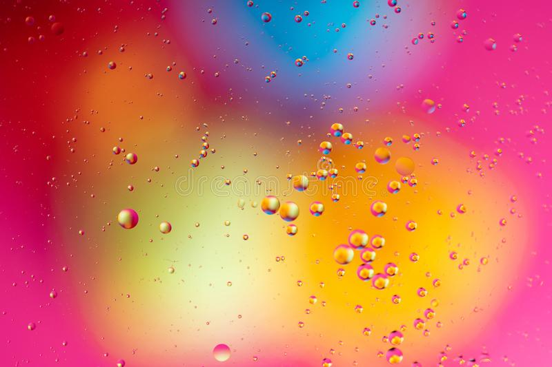 Water bubbles. Macro shot of air or molecule. Abstract space background. Abstract pattern of colored oil bubbles on water. Oil drops in water abstract stock photos