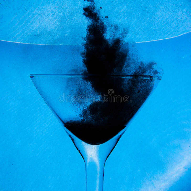 Water bubbles. Underwater air bubbles in wineglass stock image