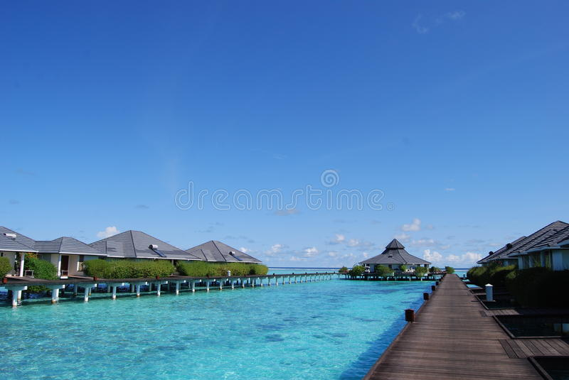 Download Water bungalows stock image. Image of clouds, islands - 12928775