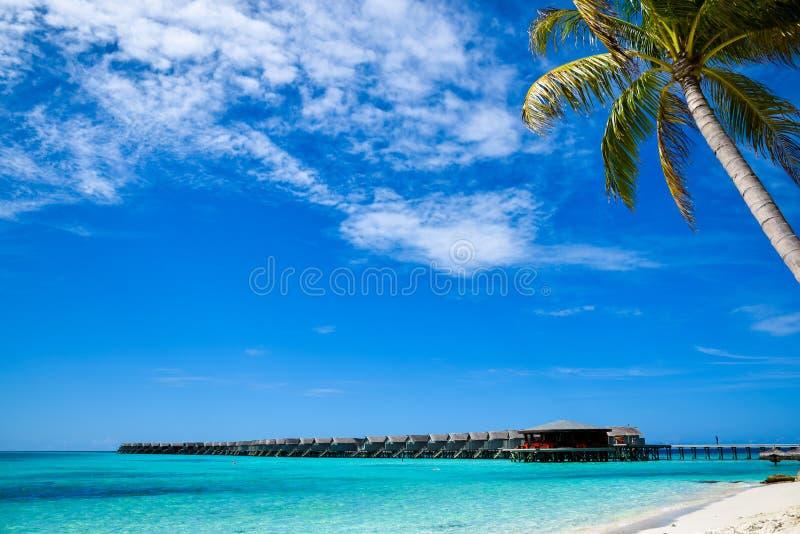 Water bungalows at beautiful tropical Maldives island luxury resort royalty free stock photo
