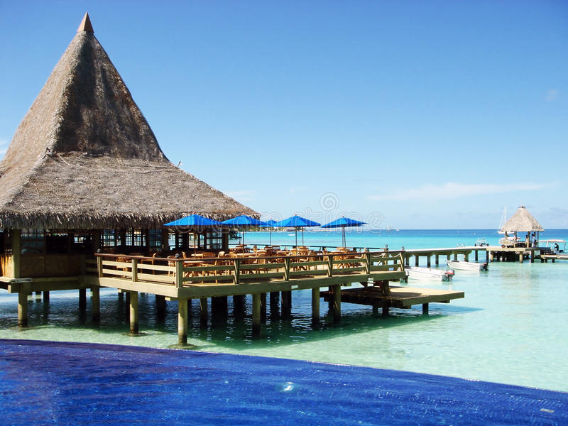 Water bungalows and blue sky and blue ocean stock image