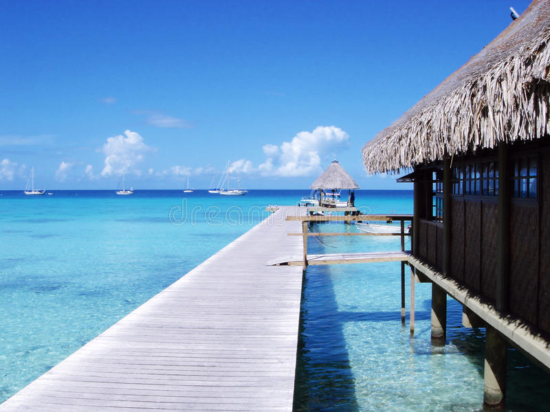 Water bungalows and blue sky and blue ocean royalty free stock images