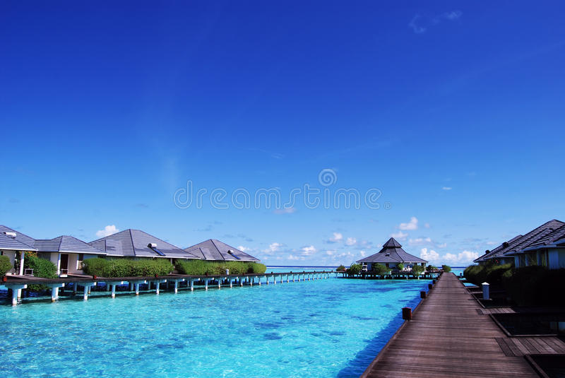 Water bungalows and blue sky and blue ocean royalty free stock photography