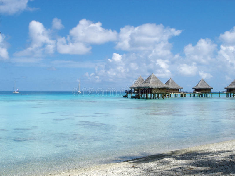 Water bungalows and blue sky and blue ocean royalty free stock photos