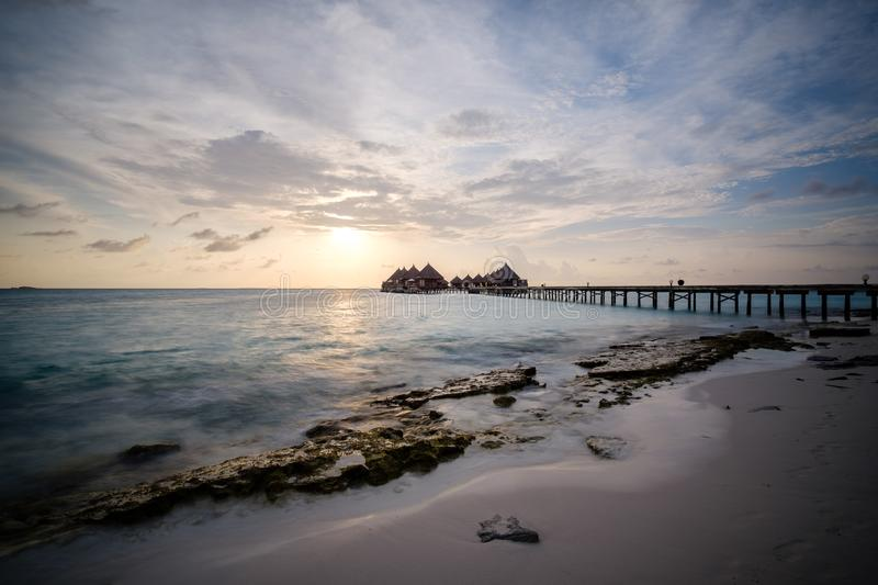 Water bungalows and jetty in indian sea royalty free stock photos