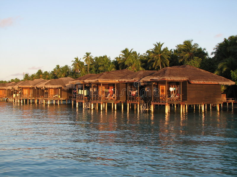 Download Water bungalows at sunset stock image. Image of island - 3045325