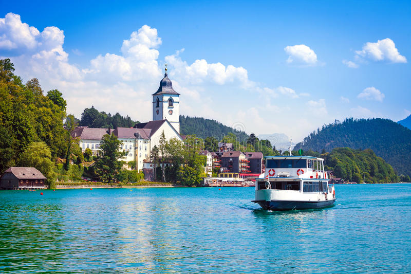 Water bus crossing Wolfgangsee. And arriving in St. Wolfgang, Austria stock photos