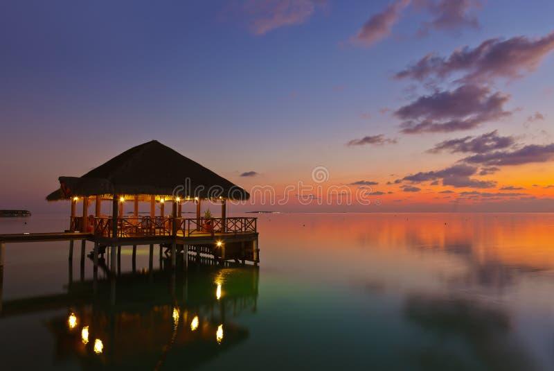 Water cafe at sunset - Maldives stock photo