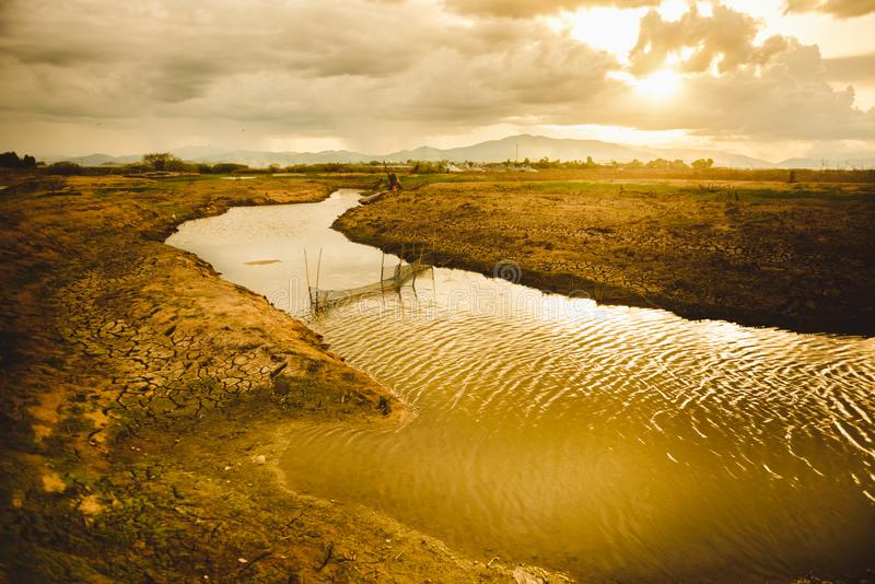 The water in canal is drying, Water crisis and Climate change concept. The water in canal is drying, Water crisis and Climate change or drought concept royalty free stock image