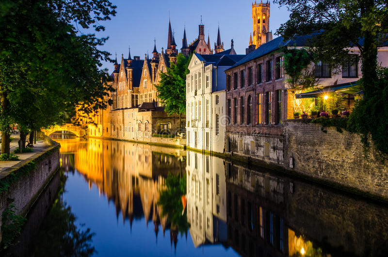 Water Canal, Medieval Houses And Bell Tower At Night In Bruges Royalty Free Stock Photo