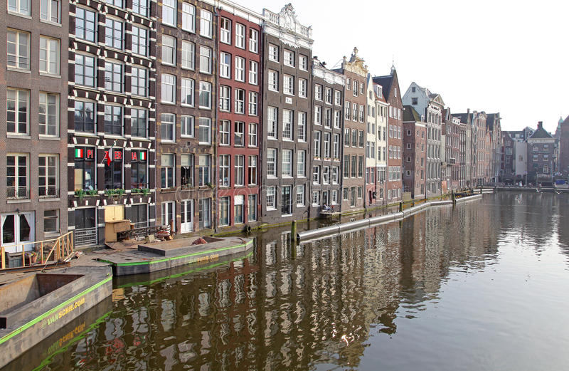 Water canal and typical architecture in Amsterdam, Netherlands stock images