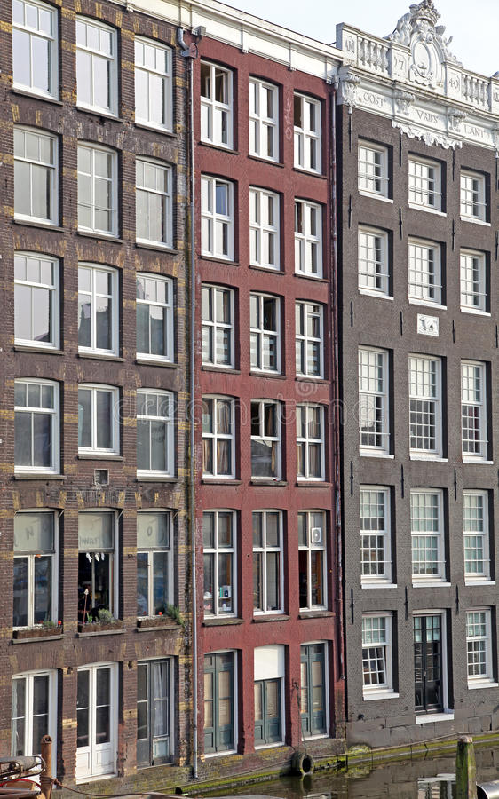 Water canal and typical architecture in Amsterdam, Netherlands royalty free stock photos