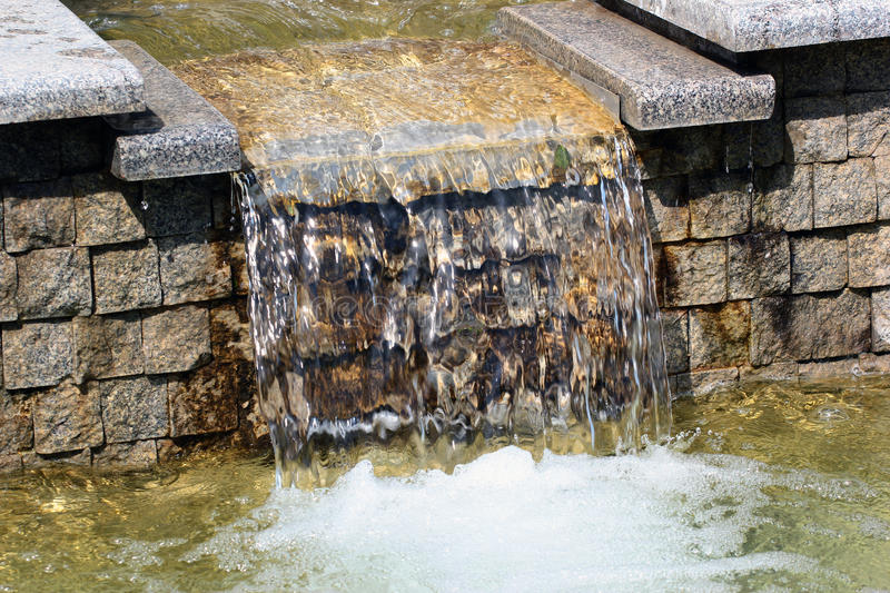 Water cascade in a park stock image