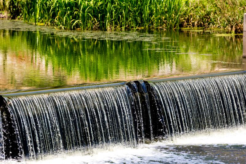 Water cascade streaming down from small dam, water saving ecology concept. Seoul, South Korea. Close up image stock photos